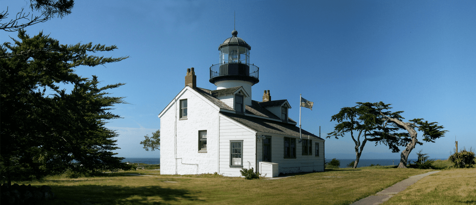 Point Pinos Lighthouse on a bright sunny day with clear blue skies