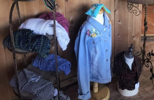 Multicolored knitted items and embroidered denim jacket for sale in the gift gallery