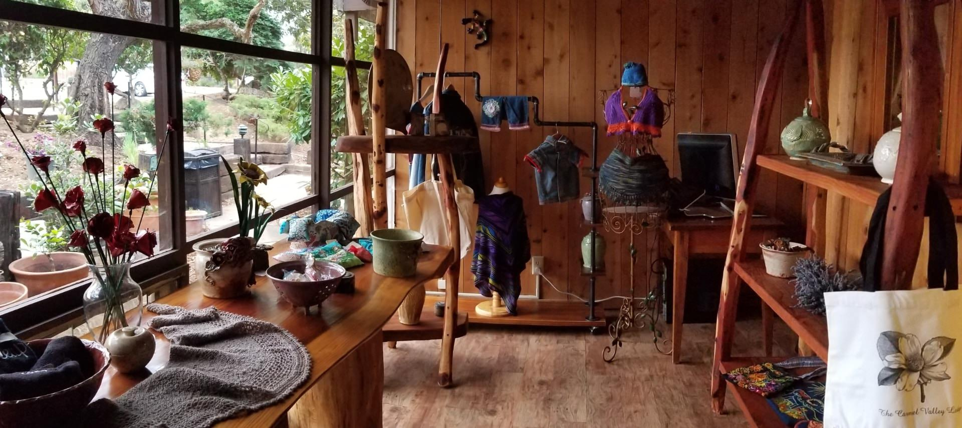 Small boutique shop with wooden furniture displaying gifts for sale