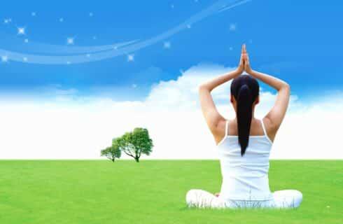 yoga pose outdoors facing the blue sky